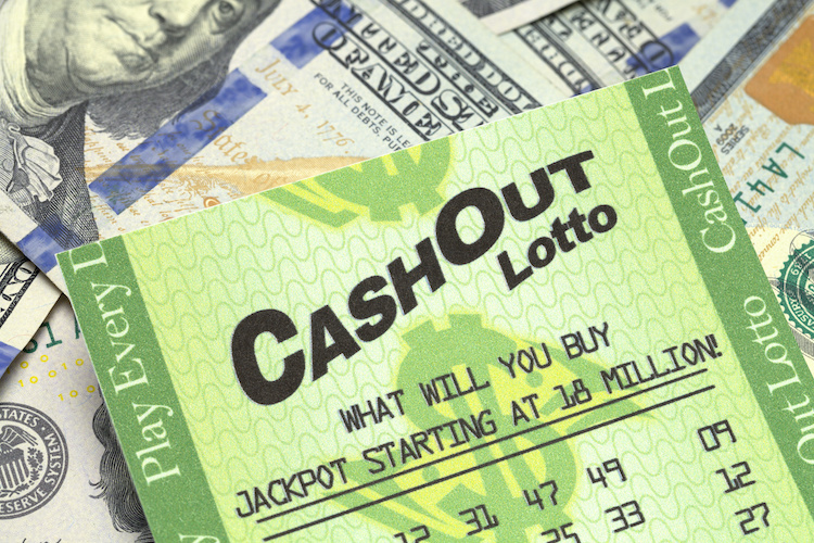 Lottery Ticket and Cash Close Up